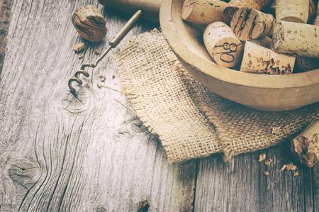 wine cork: Wine corks and corkscrew on wooden table