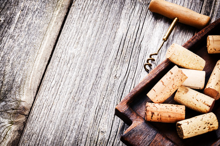 corkscrew: Wine corks and corkscrew on wooden table