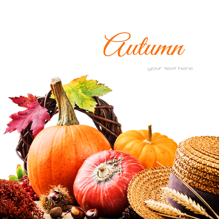 Autumn setting with harvested pumpkins and straw hat photo