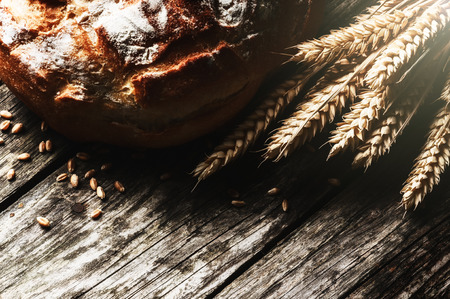 Fresh traditional bread on wooden table Stock Photo