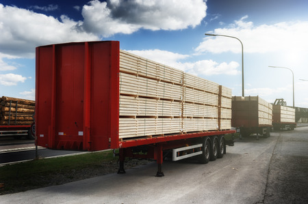 Trucks charged with wood planks waiting for delivery