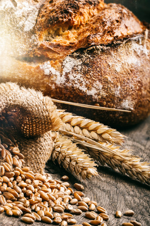 Freshly baked traditional bread in rustic setting photo