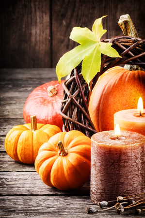 Autumn still-life in orange tone with pumpkins and candles Reklamní fotografie