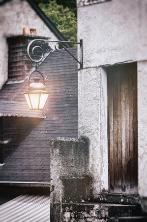architectural heritage: Ancient street lantern in small european town