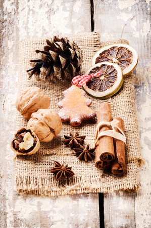 Christmas spices in festive winter setting photo