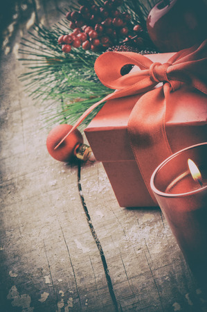 Christmas setting in retro style. Candle and gift box photo