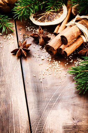 Christmas setting with seasonal spices on wooden background photo