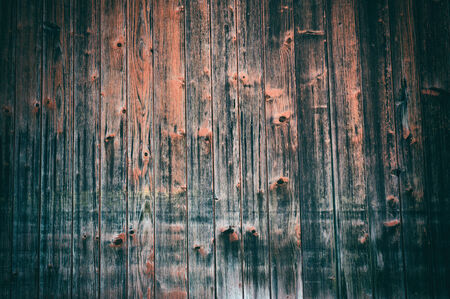 Old barn wood background in red  and brown tone photo