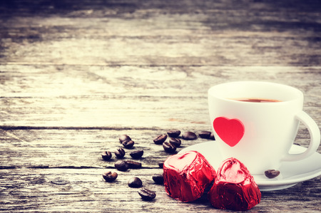 St Valentines breakfast with coffee and chocolate on wooden table photo