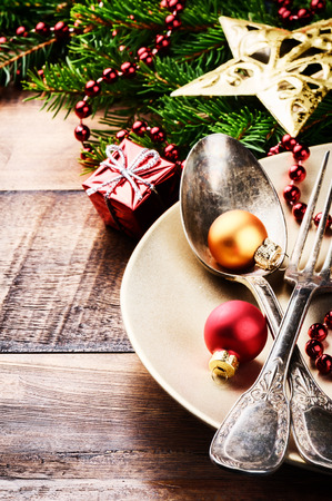 Christmas table setting in red and and gold tone photo