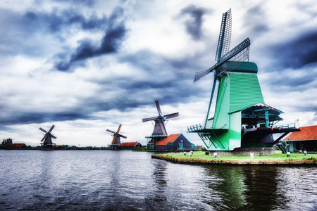 Traditional dutch windmills near the canal. Netherlands photo