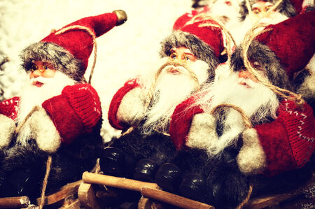 Christmas decorations with Santa Clauses on wooden sledge photo