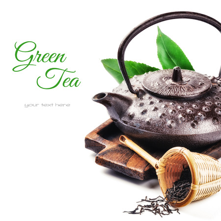 oriental medicine: Closeup of asian teapot and dried tea. Health and diet concept