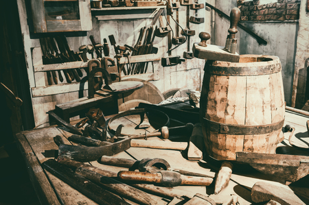 Old hand tools in vintage workshop setting photo