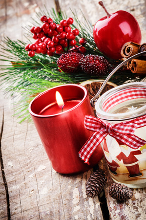 Christmas decorations with various candles in red tone photo