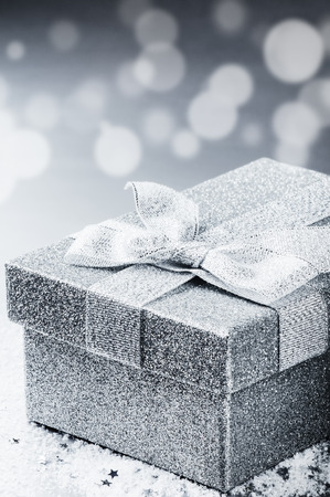 chrstmas: Chrstmas present in silver shiny box. Holiday greeting card concept
