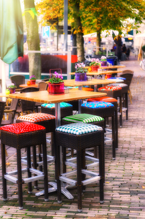 european culture: Cafe terrace in autumn city. The Netherlands, Europe