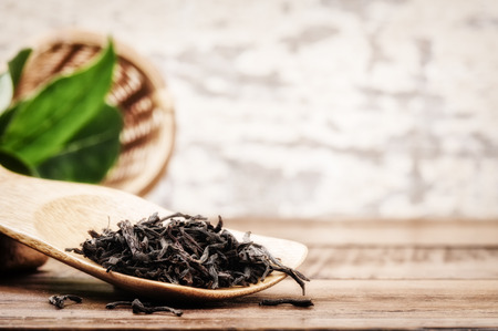 Closeup of dry black tea. Health and diet concept