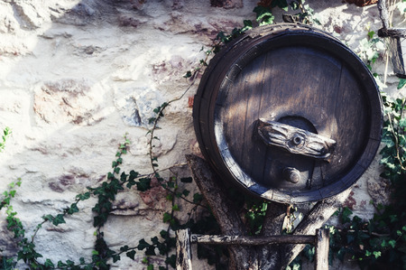 distillery: Old wooden wine barrel used as outdoor decoration Stock Photo