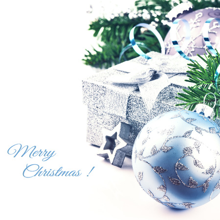 Christmas setting with present and festive ornaments isolated over white photo