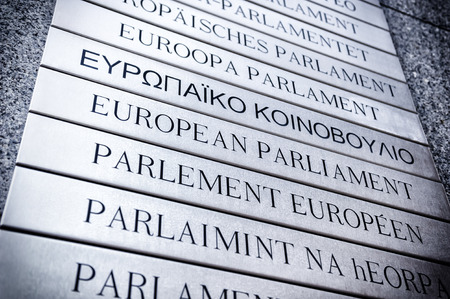 Nameplate in all EU languages in front of the European Parliament. Brussels, Belgium