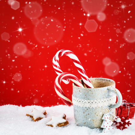 Christmas setting with winter holiday sweets on red background photo