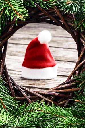 Santas hat in festive Christmas setting photo