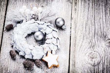 Festive background with Christmas wreath and pine cones photo
