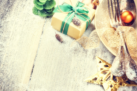 Christmas table setting with present in gold and green tone Stock Photo