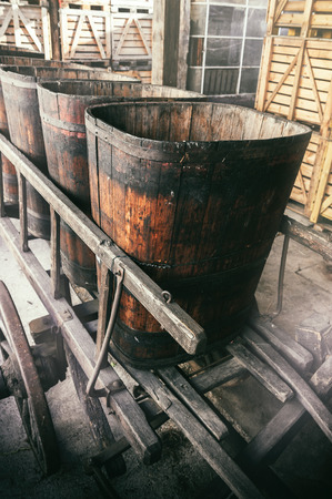 vats: Old wooden wheelbarrow with vats for grape transportation