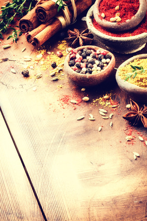 curry powder: Colorful mix of various spices and herbs in rustic setting