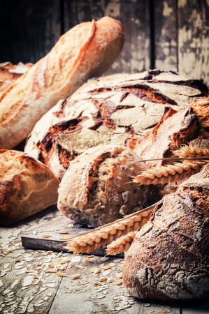 Freshly baked bread in rustic setting. Farm and agriculture concept photo