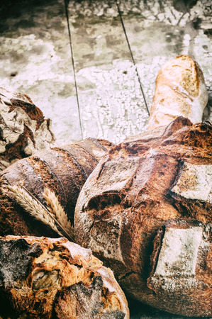 rustic food: Freshly baked bread in rustic setting. Agriculture and food Stock Photo