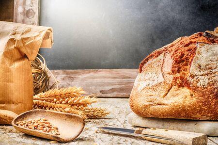 Freshly baked bread in rustic setting with copyspace on blackboard photo