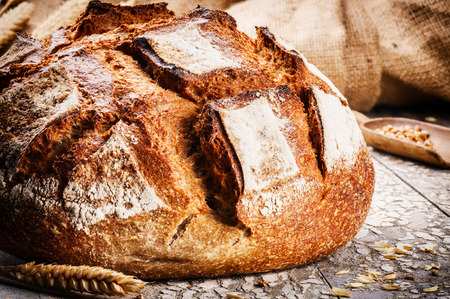 Freshly baked traditional bread in rustic setting Stock Photo