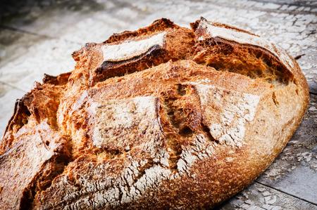 Freshly baked bread loaf. Closeup shot photo