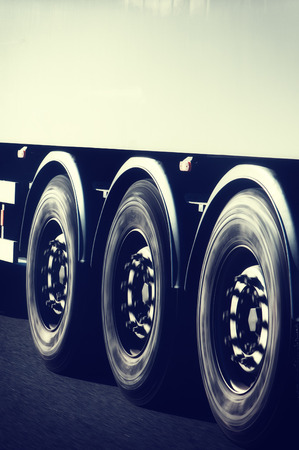 Truck wheels closeup in motion with copyspace