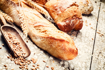 Freshly baked bread in rustic setting with copyspace photo