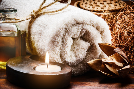 Spa setting with towel and candle in brown tone