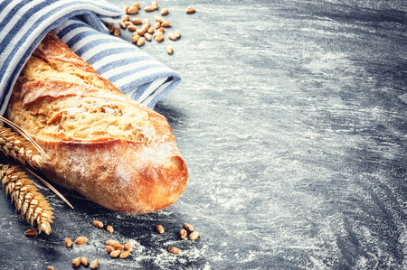 Freshly baked baguette in rustic setting with copyspace photo