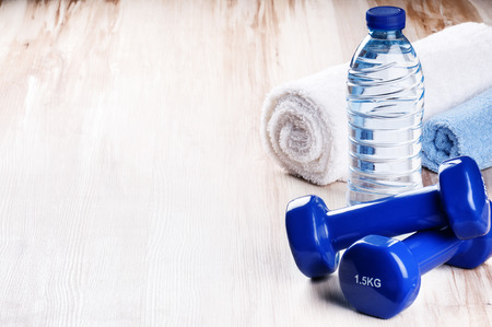 Fitness concept with dumbbells and water bottle. Workout setting 스톡 콘텐츠