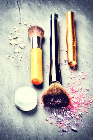 Makeup Brushes And Products On Dark Background Stock Photo