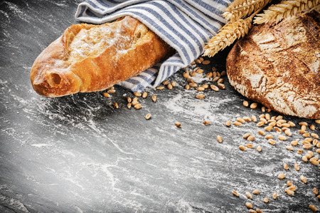 copyspace: Freshly baked bread and baguette in rustic setting with copyspace