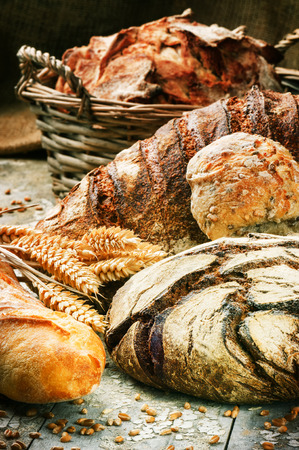 Freshly baked bread in rustic setting Stock Photo