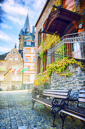 Wooden benches in small european town photo