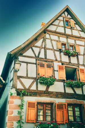 Traditional timber frame house at summer time. Alsace, France photo
