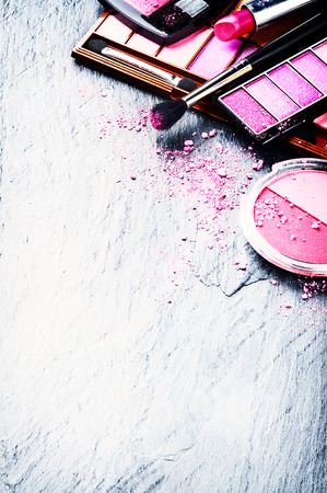 text pink: Various makeup products in pink tone with copyspace