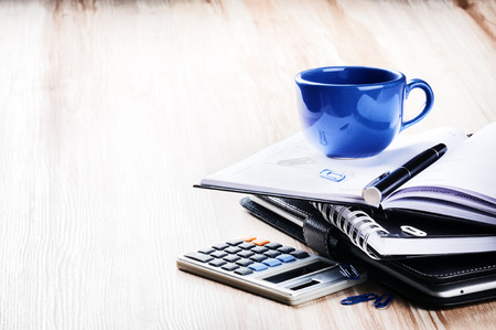 Business concept with agenda and coffee cup. Copy space