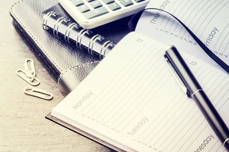 Business concept with agenda, mobile phone and calculator. Copy space
