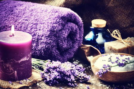 Spa setting with candle and lavender flowers. Wellness concept